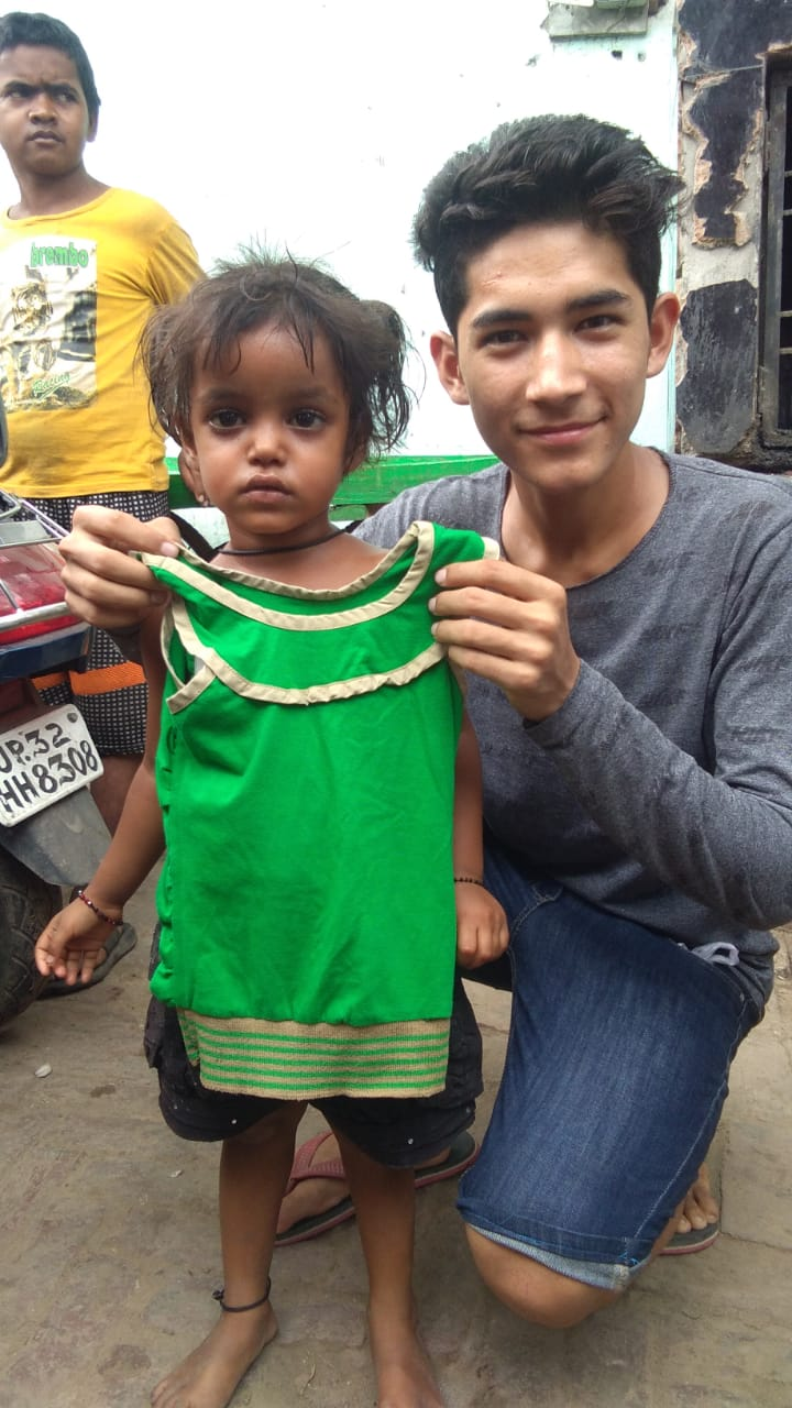 Pradeep bought a dress from Amminabad with his birthday money and gave it to this homeless little girl.